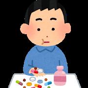 薬を飲む人